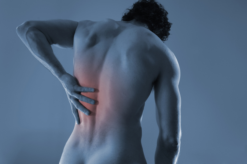 man suffering from a chronic back pain